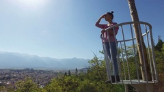 Female at lookout observation deck view point observe beautiful nature Stock Footage
