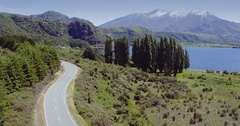 Aerial of car driving on country road, lake wanaka, New Zealand Stock Footage