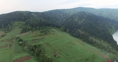 Panoramic shooting high above the ground wooded hills and river Stock Footage