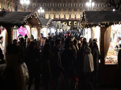 People shopping on night in the Christmas market of Turin, Italy Stock Footage
