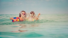 Happy family on summer vacation. Slow motion Stock Footage