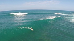 Aerial view of a wipeout while sup stand-up paddleboard surfing in Hawaii, slow Stock Footage