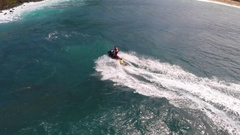Aerial view of lifeguard surf rescue jetski personal watercraft in Hawaii, slow Stock Footage