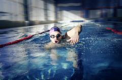 Swimmer  swims in the pool. Kuvituskuvat