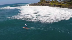 Aerial view of a man paddling while sup stand-up paddleboard surfing in Hawaii, Stock Footage