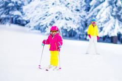 Family ski and snow fun in winter mountains Stock Photos