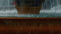 Closeup detail of a large fountain in Trafalgar Square, London, England, UK Stock Footage