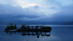 Floating boat island at the riverside of the Shui She Wharf at sunrise Stock Footage