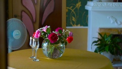 Interior living room, red roses in a vase on a table Stock Footage