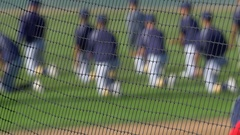 Baseball players warm up and practice before a game. Stock Footage