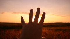 Male hand reaching for sun Stock Footage