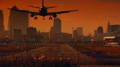 London City Airport - Closeup of a large commercial airliner landing by sunset Stock Footage
