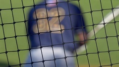 A baseball player batter makes a play at a game. Stock Footage