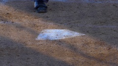 An umpire brushes off home plate at a baseball game, slow motion. Stock Footage