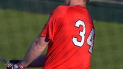 A baseball player makes a play at a game, slow motion. Stock Footage