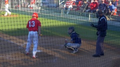 A baseball player batter catcher umpire makes a play at a game. Stock Footage