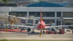 AirAsia airplanes at Phuket Airport Stock Footage