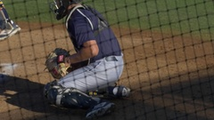 A baseball player catcher makes a play at a game. Stock Footage