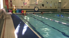 Boys have swimming lessons in a pool. Stock Footage