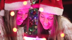 Excited Beautiful Twin Sisters Amazed Opening Magical Christmas Gift Stock Footage