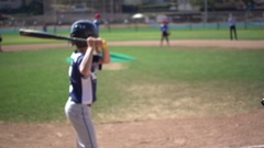 Boys playing in a little league baseball game, super slow motion. Stock Footage