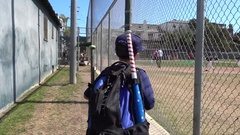 A boy walks to a little league baseball game. Stock Footage