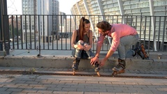 Woman and man on rollerblades. Stock Footage