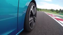 CLOSE UP: White racecar passing blue sportscar on racing circuit competition Stock Footage