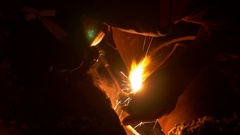 A welder welding a ruptured heating pipe at night Stock Footage