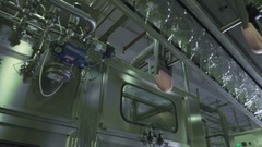 Clear Bottles transfer on Conveyor hanging System Stock Footage