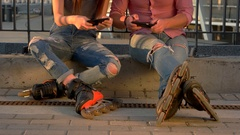 Couple on rollerblades is sitting. Stock Footage