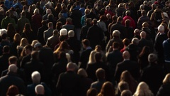 Medium telephoto shot of an anonymous cross-generation crowd Stock Footage