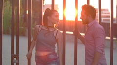 Man and woman talking outdoor. Stock Footage
