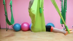 Anti-gravity Yoga, athletic woman doing yoga exercises indoor Stock Footage