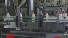 Dairy Plant. Conveyor with milk bottles. Stock Footage