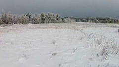 Aerial shot of snow-covered field Stock Footage