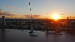 Golden hour sunset aerial shot showing the river Thames Stock Footage