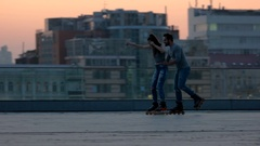 Couple rollerblading in the evening. Stock Footage