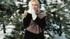 Beautiful woman jumps on frost to get warmed, winter landscape Stock Footage