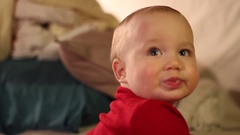 Home movies of a baby in a family wearing a red sweater. Stock Footage