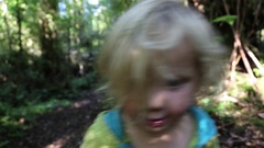 Home movies of a baby in a family on a forest trail. Stock Footage