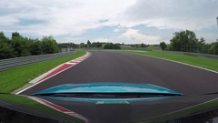 FPV: Blue racecar driving very fast on twisty racetrack circuit on grand prix Stock Footage
