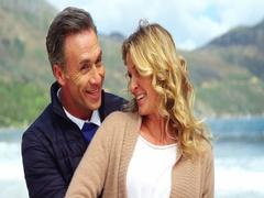Mature couple enjoying on beach Stock Footage