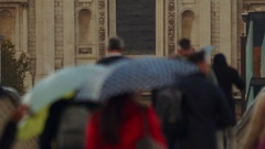 A lady in red walking along a group of anonymous people in Central London Stock Footage
