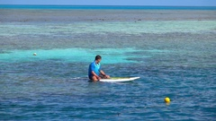 Great Barrier Reef, Corals Surfacing, Man on Surf, Slow Motion Stock Footage