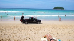 PHUKET, THAILAND - NOVEMBER 2016 : Police car truck rides on the sand of Stock Footage