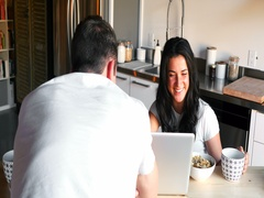 Couple using laptop while having breakfast Stock Footage