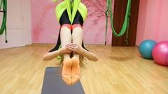 Anti-gravity Yoga, athletic woman doing yoga exercises indoor Stock Footage