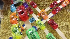 Colorful plastic toy cars of different colors. Stock Footage