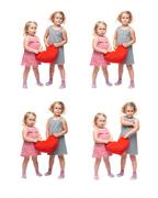 Couple of young little girls standing over isolated white background Stock Photos